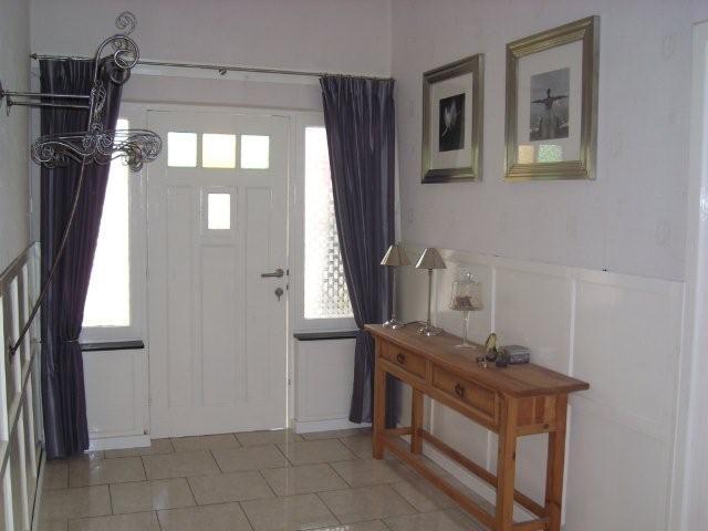 woonkamer op zolder wasmachine achter deur het kastenhuishet kastenhuis